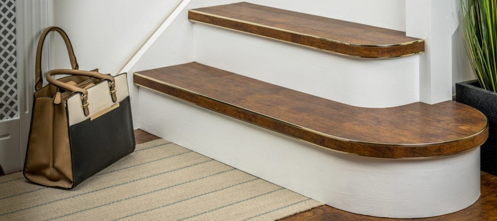 Bendybull stair nosing fitted to LVT on stairs