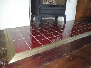 Posh door threshold trim around a fireplace