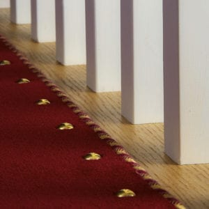 Easybind carpet binding with matching carpet studs on staircase create attractive stair runner