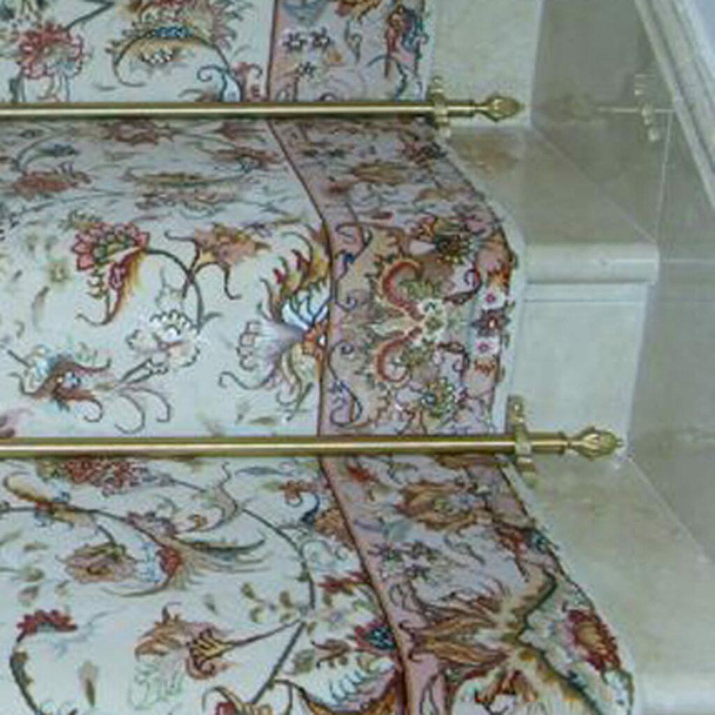 Carpet runner rails for wider staircases