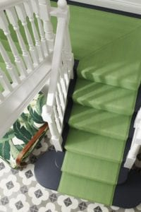 Lime green stair runner on white and black staircase