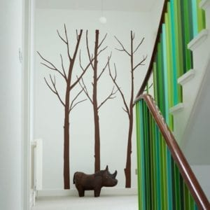 staircase with green spindles