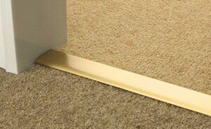 Double Z9 door threshold connecting in doorway two beige carpets