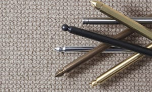 Pile of Premier designs of stair rods, variety of finishes