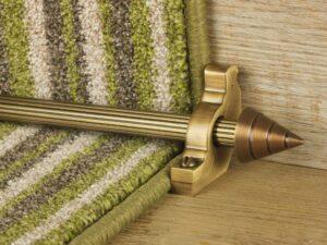 Arrow runner carpet rod, fluted rod design, arrow-shaped end, bracket, antique brass