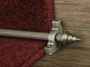Arrow runner carpet rod, fluted rod design, arrow-shaped end, bracket, pewter