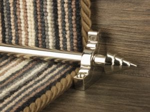 Arrow head on plain stair rod in Polished Nickel, matching bracket, fitted on step with deep red stair carpet
