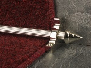 Arrow head on reeded stair rod in Polished Nickel, matching bracket, fitted on step with deep red stair carpet