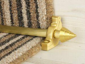 Arrow runner carpet rod, fluted rod design, arrow-shaped end, bracket, satin brass
