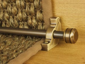 Piston stair rod in antique brass fitted to sisal stair carpet