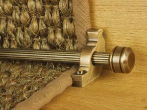 Piston runner carpet rod, fluted rod design, grooved ball end, bracket, antique brass