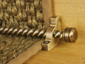 Piston runner carpet rod, twisted rod design, grooved ball end, bracket, antqieu brass