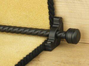 Piston runner carpet rod, twisted rod design, grooved ball end, bracket, black