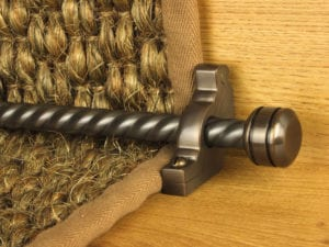 Piston runner carpet rod, twisted rod design, grooved ball end, bracket, bronze