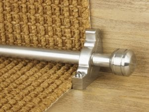 Piston stair rod in brushed chrome fitted to sisal stair carpet