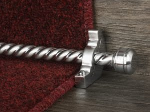 Sherbourne stair rod with spiral brushed rod in chrome fitted to burgundy stair carpet