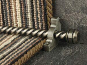 Piston runner carpet rod, twisted rod design, grooved ball end, bracket, pewter