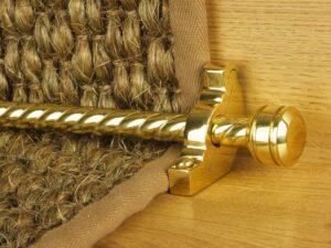 Piston runner carpet rod, twisted rod design, grooved ball end, bracket, polished brass