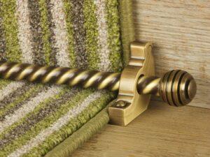 Sphere runner carpet rod, twisted design, grooved ball end, antique brass