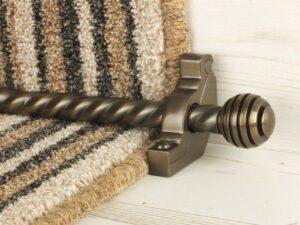 Sphere runner carpet rod, twisted design, grooved ball end, bronze