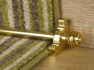Sphere stair rods polished brass on green striped runner
