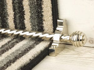 Sphere carpet rod with spiral rod and spherical end, satin nickel, fitted to black and white stair runner on step