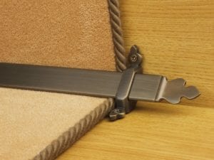 Beaumont design of stair rod with decorative ends, bronze, fitted to stair runner