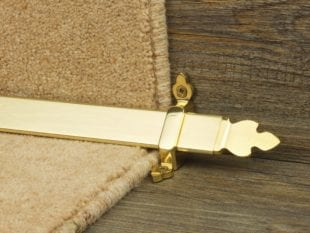 Beaumont triangular stair rod in polished brass on staircase