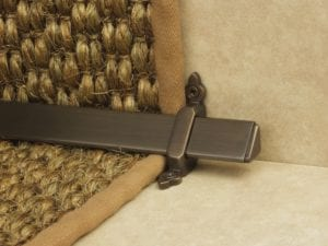 Vue design of stair rod with flat ends, bronze, fitted to stair runner