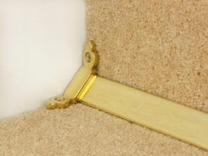 Louis design of stair rod polished brass, attached to side of step