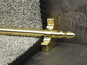 Homepride polished brass stair rod with matching bracket, attached to flecked carpet