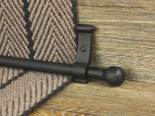 Blacksmith ball stair rod for runners on striped carpet