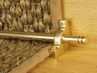 Balmoral runner carpet rod with matching bracket in polished brass attached to coir stair runner