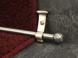 Ball carpet rod om Stainless Steel with winder bracket, fitted on red stair runner
