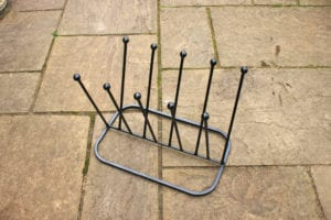 5 pair Black Boot rack on paved terrace