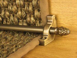 sherwood carpet rod with fir cone finial, bracket in antique brass
