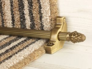 sherwood carpet rod with fir cone finial, bracket in antique brass