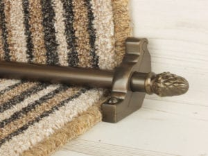 sherwood carpet rod with fir cone finial, bracket in bronze