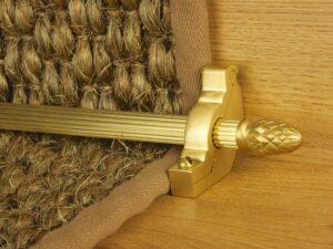 Sherwood carpet rod with fir cone finial, bracket in satin brass