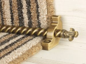 Bordeaux stair carpet rod, decorative end, twisted design rod on runner, antique brass