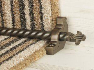 Bordeaux stair carpet rod, decorative end, twisted design rod on runner, bronze