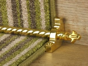 Bordeaux stair carpet rod, decorative end, twisted design rod on runner, polished brass
