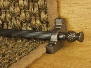 Arran stair carpet rod, thistle end, fluted rod, bracket, bronze