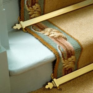 Beaumont triangular stair rod on bordered stair runner