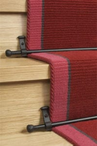 Ball stair rod fitted on red stair runner