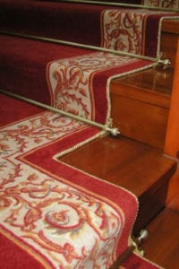 Easybind carpet edging, patterned red and gold carpet, Dubai stair rods