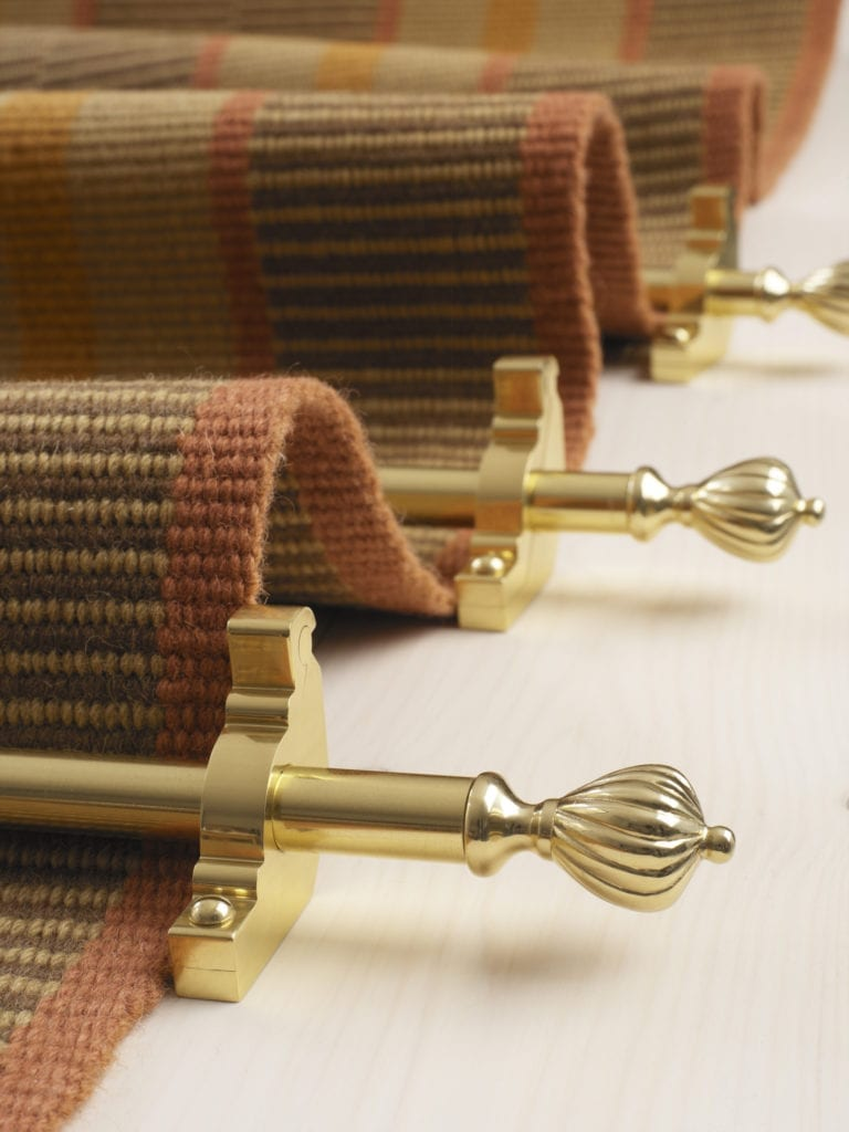 Cairo 16mm stair rods on undulating runner, polished brass, close-up