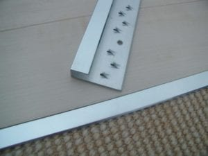Feline Edge door threshold, chrome , joins carpet to a hard floor