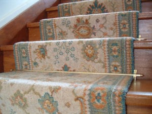 Lancaster stair rods, patterned, blue runner carpet, wooden staircase