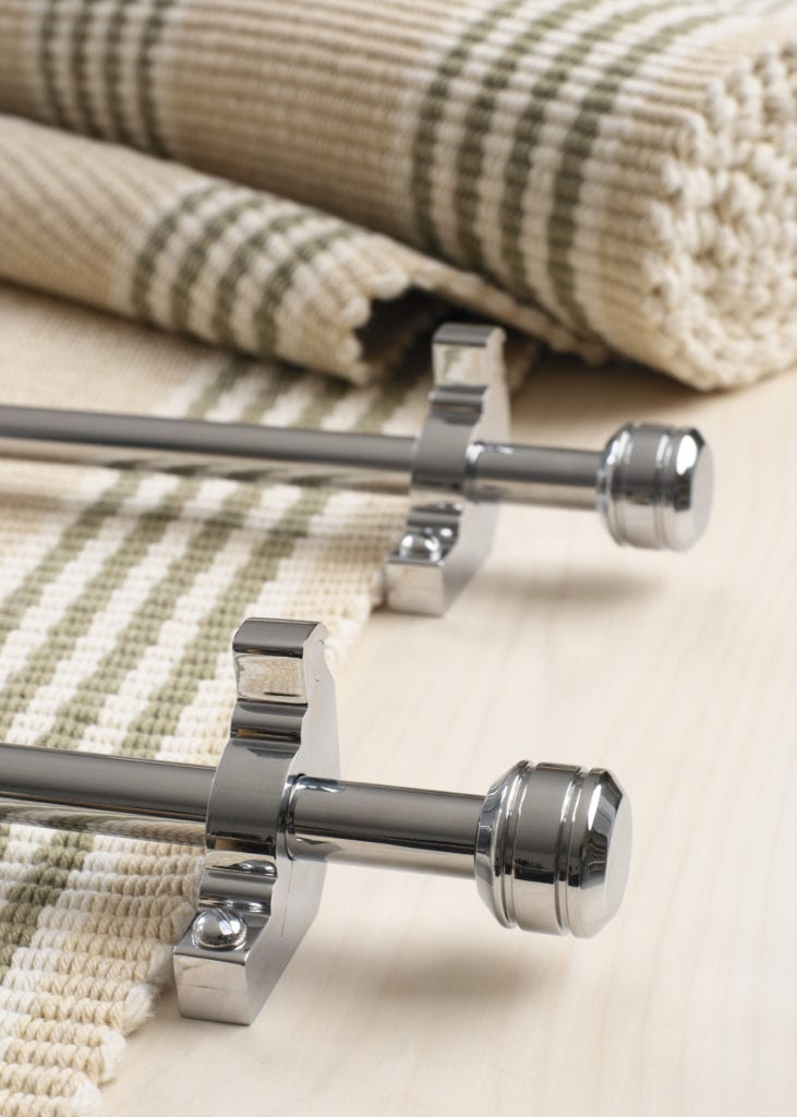 Piston stair rods polished chrome on striped carpet